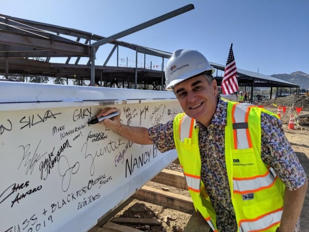 Mike signing beam at Animal Shelter Construction Site