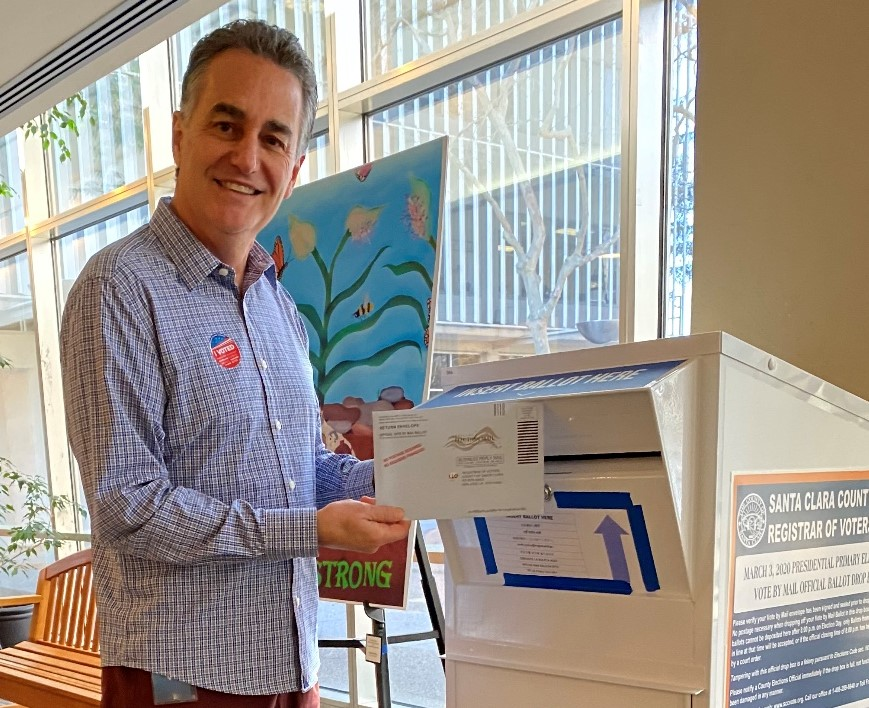 Photo of Mike Wasserman mailing his voting ballot